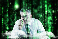 Composite image of mature businessman examining with magnifying glass Stock Image