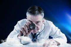 Composite image of mature businessman running diagnostics Stock Photo
