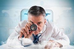 Composite image of mature businessman running diagnostics Royalty Free Stock Photos