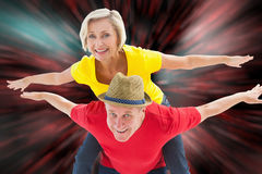 Composite image of mature couple joking about together Royalty Free Stock Images