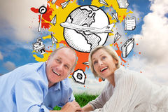 Composite image of mature couple lying and smiling Royalty Free Stock Photos