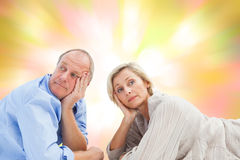 Composite image of mature couple lying and thinking Stock Photos