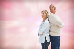 Composite image of mature couple standing and thinking Royalty Free Stock Photo