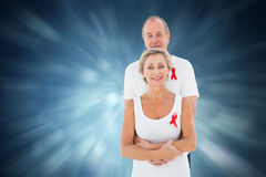 Composite image of mature couple supporting aids awareness together Royalty Free Stock Photography