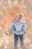 Composite image of mature man carrying his partner on his back Stock Image