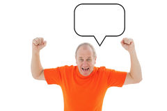Composite image of mature man in orange tshirt cheering Stock Photography