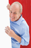 Composite image of mature man smiling at camera around card Stock Photography