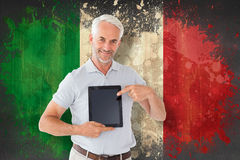 Composite image of mature student showing tablet pc Stock Image