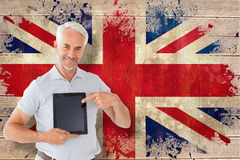Composite image of mature student showing tablet pc Royalty Free Stock Image