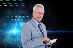 Composite image of mature tradesman with tablet computer Royalty Free Stock Photos