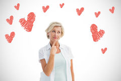 Composite image of mature woman thinking with hand on chin Royalty Free Stock Photography
