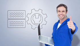 Composite image of mechanic holding laptop while showing thumbs up Stock Photography