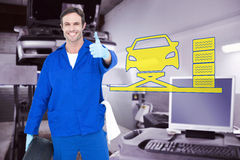 Composite image of mechanic holding tire while showing thumbs up. Mechanic holding tire while showing thumbs up against auto repair shop Royalty Free Stock Photos