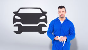 Composite image of mechanic wiping hands with cloth Royalty Free Stock Photos