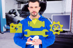 Composite image of mechanic wiping hands with cloth Royalty Free Stock Photography