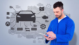 Composite image of mechanic writing on clipboard Royalty Free Stock Photos