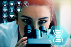 Composite image of medecine. Medecine against close up of a scientist posing with a microscope Stock Image