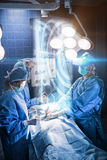 Composite image of medical interface on xray. Medical interface on xray against surgeons performing operation in room Royalty Free Stock Photo