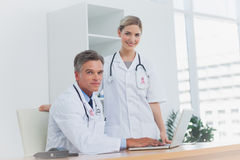 Composite image of medical team at the office Stock Photos