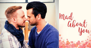 Composite image of men couple embracing and valentines words. Composite image of men couple embracing against backgrounds working Royalty Free Stock Photos