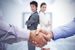 Composite image of men shaking hands Royalty Free Stock Images