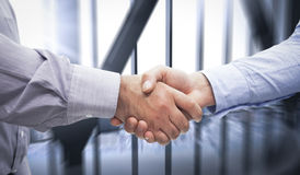 Composite image of men shaking hands Stock Photos