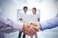 Composite image of men shaking hands Royalty Free Stock Photo