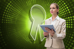 Composite image of merit badge and businesswoman using tablet. Against green pixel spiral Royalty Free Stock Image