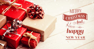 Composite image of merry christmas message. Merry Christmas message against high angle view of gift boxes Stock Photography