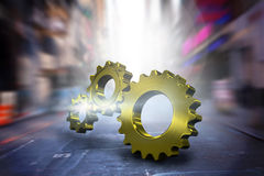 Composite image of metal cog and wheel connecting Royalty Free Stock Photo