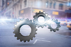 Composite image of metal cogs and wheels connecting Royalty Free Stock Image