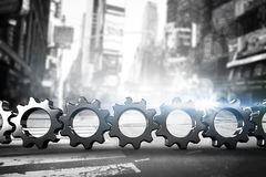 Composite image of metal cogs and wheels connecting Stock Images
