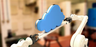 Composite image of metallic robotic hands holding cloud against background Stock Photos