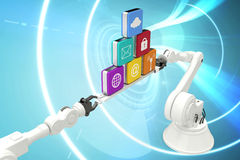 Composite image of metallic robotic hands holding computer icons over blue background Royalty Free Stock Photography