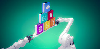 Composite image of metallic robotic hands holding computer icons over green vignette Royalty Free Stock Images