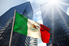 Composite image of mexico national flag. Mexico national flag against low angle view of skyscrapers Royalty Free Stock Photos