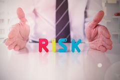 Composite image of mid section of businessman with colorful risk text Royalty Free Stock Image