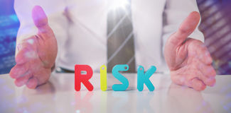 Composite image of mid section of businessman with colorful risk text Royalty Free Stock Photography