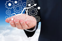 Composite image of mid section of a businessman with hands out Stock Photos