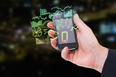 Composite image of mid section of a businessman holding smartphone 3d. Mid section of a businessman holding smartphone against traffic lights at night 3d Stock Photos