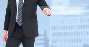 Composite image of mid section businessman pointing with his finger royalty free stock image