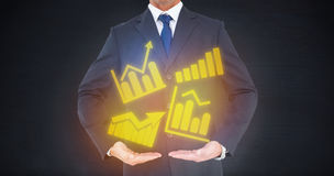 Composite image of mid section of a businessman in suit with hands out Royalty Free Stock Photo