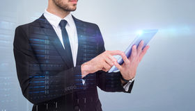 Composite image of mid section of a businessman using digital tablet pc Stock Photo