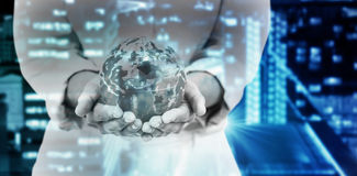 Composite image of mid section of businesswoman holding globe Stock Photos
