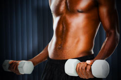Composite image of mid section of fit shirtless man lifting dumbbells Stock Photos