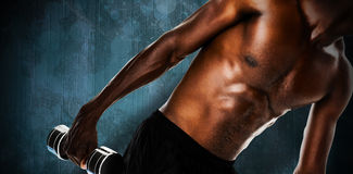 Composite image of mid section of fit shirtless young man lifting dumbbell Stock Photography