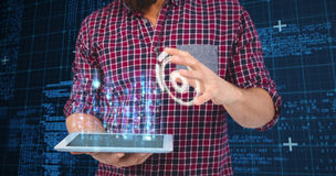 Composite image of mid section of man gesturing while holding digital tablet Stock Photography