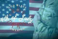 Composite image of mid section of military soldier taking oath. Mid section of military soldier taking oath against digitally generated image of happy 4th of Stock Image