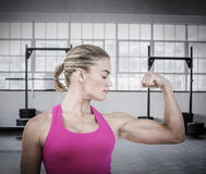 Composite image of mid section of muscular woman flexing muscle Royalty Free Stock Photos