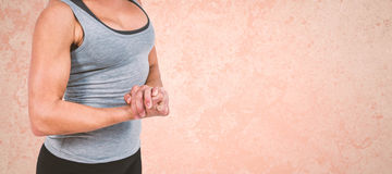 Composite image of mid section of muscular woman flexing muscle Stock Image